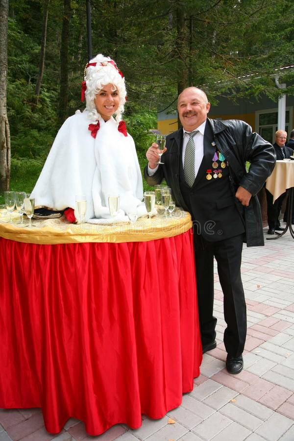 A lady-drink, a Girl table, Living table and the old man veteran. The reception in the restaurant country club Villa, Priozersky district, Leningrad oblast royalty free stock images
