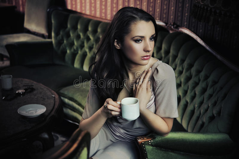 Lady drinking coffee stock photography