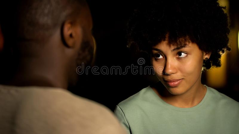 Lady embracing boyfriend, looking with love, feeling seduction, intimate date. Stock photo stock photo