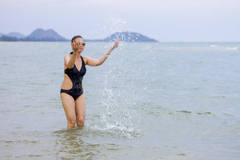 Lady enjoy play water. In Ban Krut Beach, at Prachuap Khirikhun Province Thailand stock image