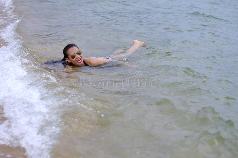 Lady enjoy swim wate. R in Ban Krut Beach, at Prachuap Khirikhun Province Thailand royalty free stock image