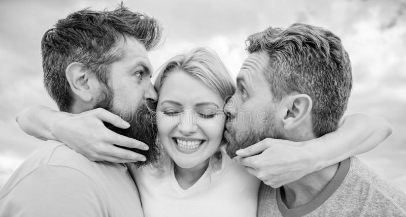Lady enjoy romantic relations both admirers. Men fall in love with same woman. She likes male attention. Love triangle. Lady enjoy tic relations both admirers stock photography