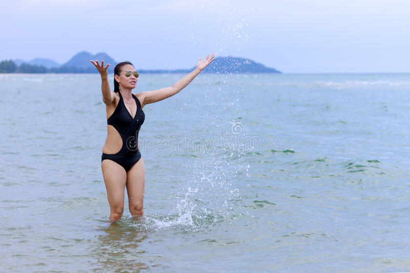 Lady enjoy water. In Ban Krut Beach, at Prachuap Khirikhun Province Thailand royalty free stock photo