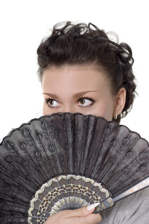 Lady with fan. Cute brunette with a black fan over white royalty free stock images