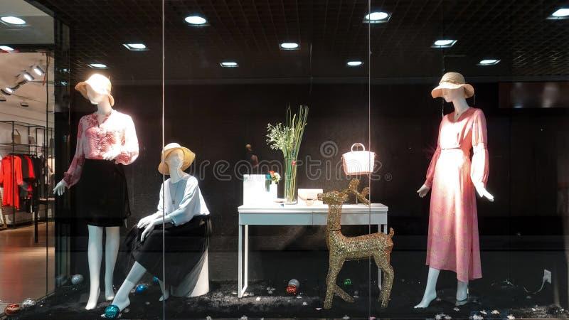 Lady fashion  retail shop window front stock photo
