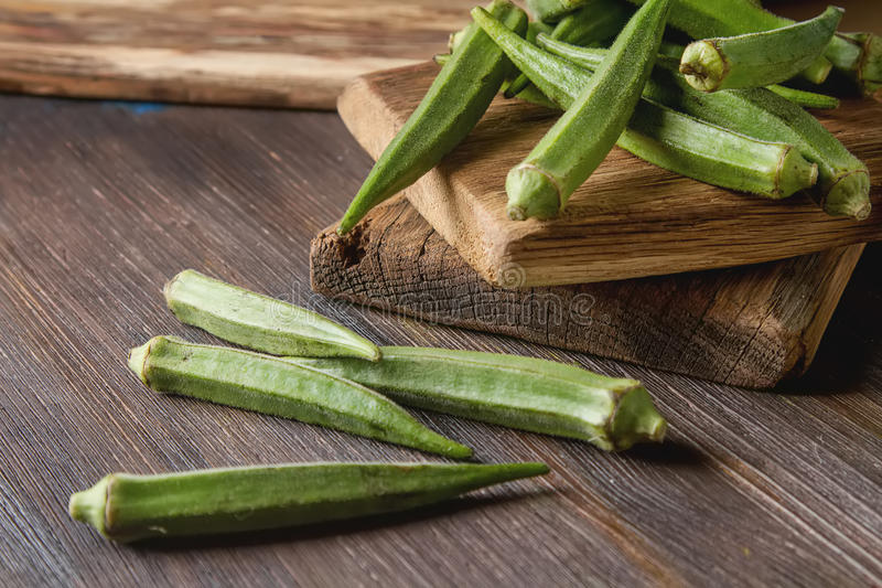 Lady Fingers or Okra over wooden table background. royalty free stock photos