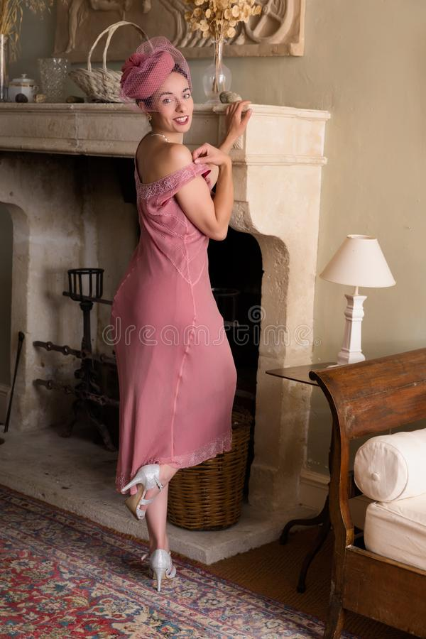 Lady in flapper dress at fireplace royalty free stock photos