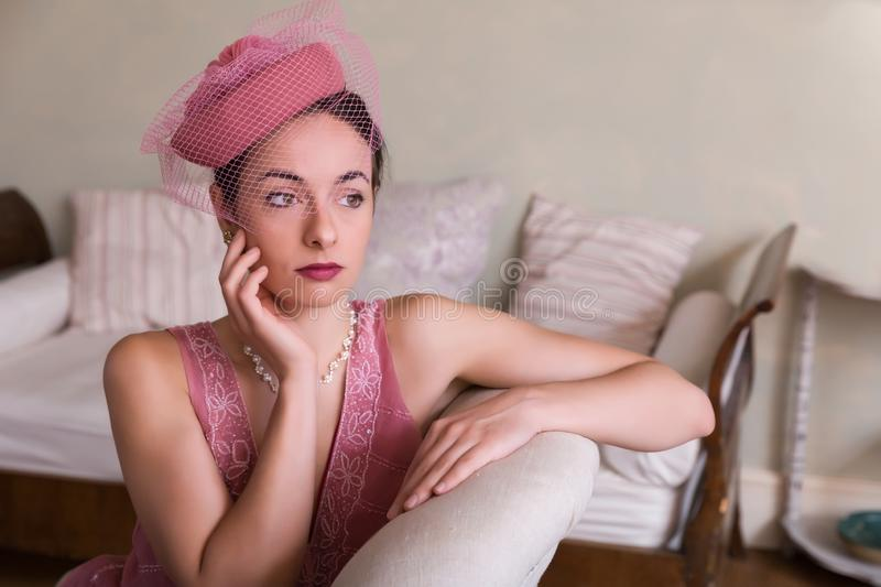 Lady in flapper dress on settee royalty free stock image