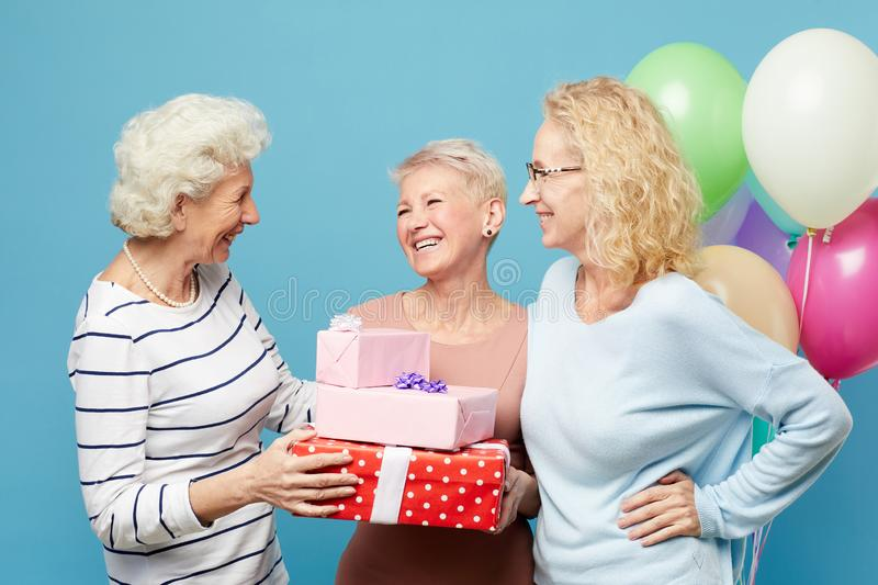 Lady friends congratulating birthday woman royalty free stock images