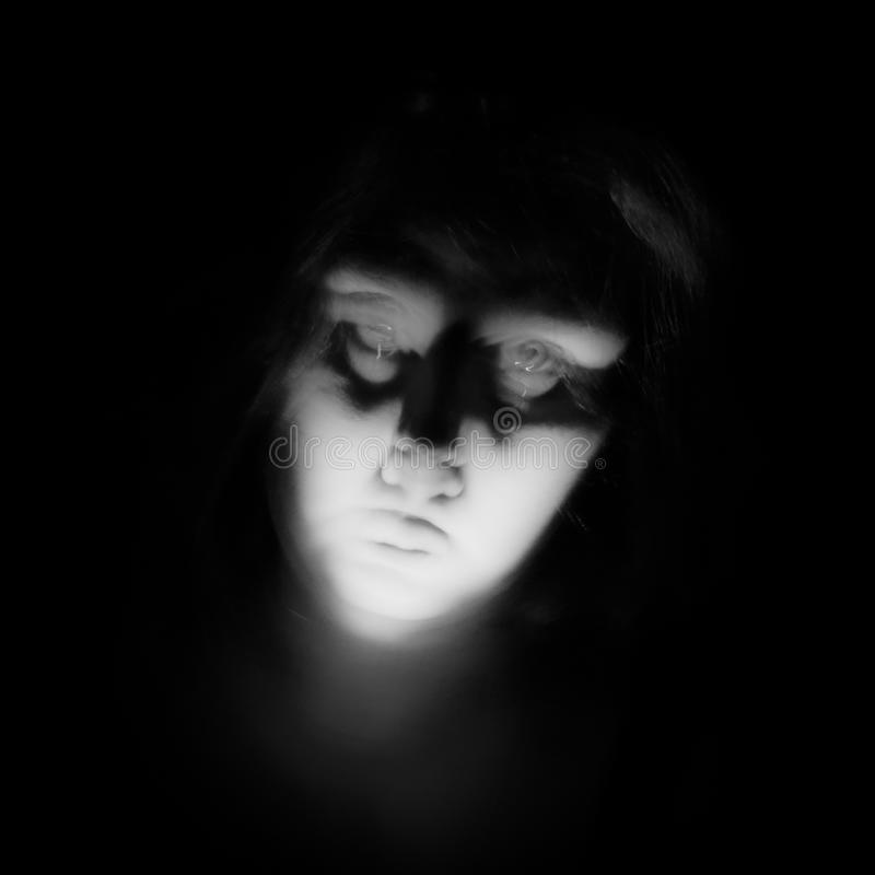 Lady Ghost. A female ghostly figure; black and white colortone; square format royalty free stock photo