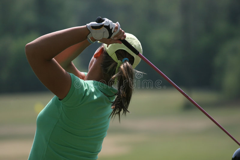 Lady golf swing stock images