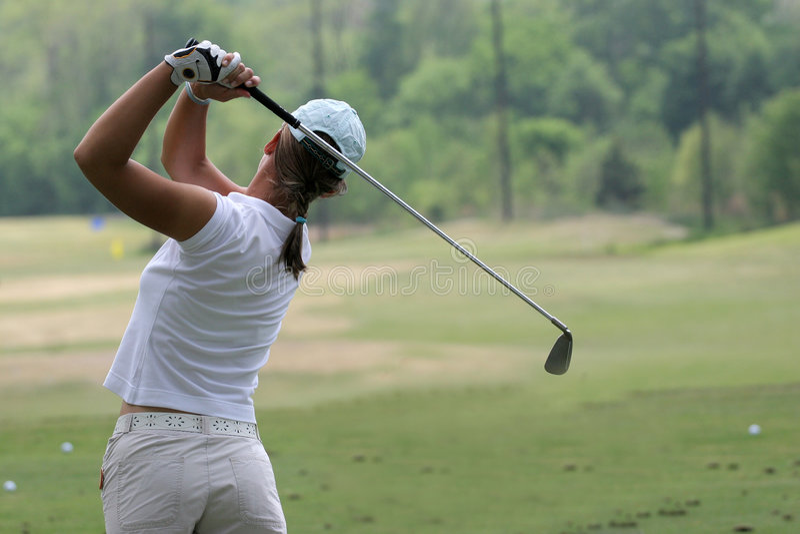 Lady golf swing stock photography