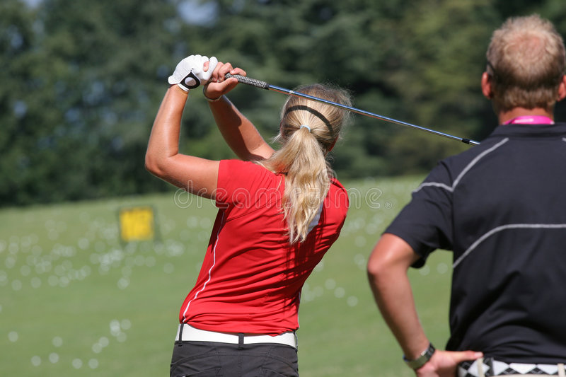 Lady golf swing royalty free stock images