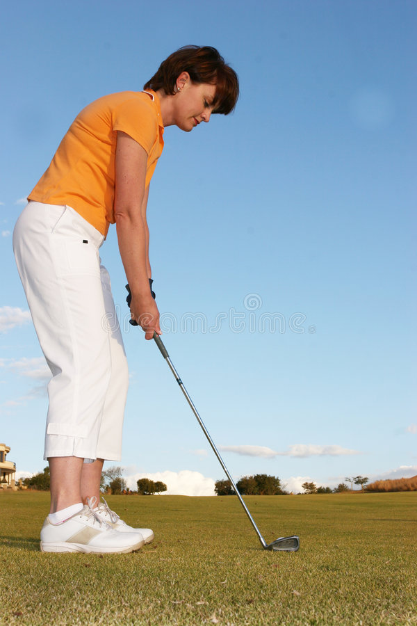 Lady Golfer stock photography