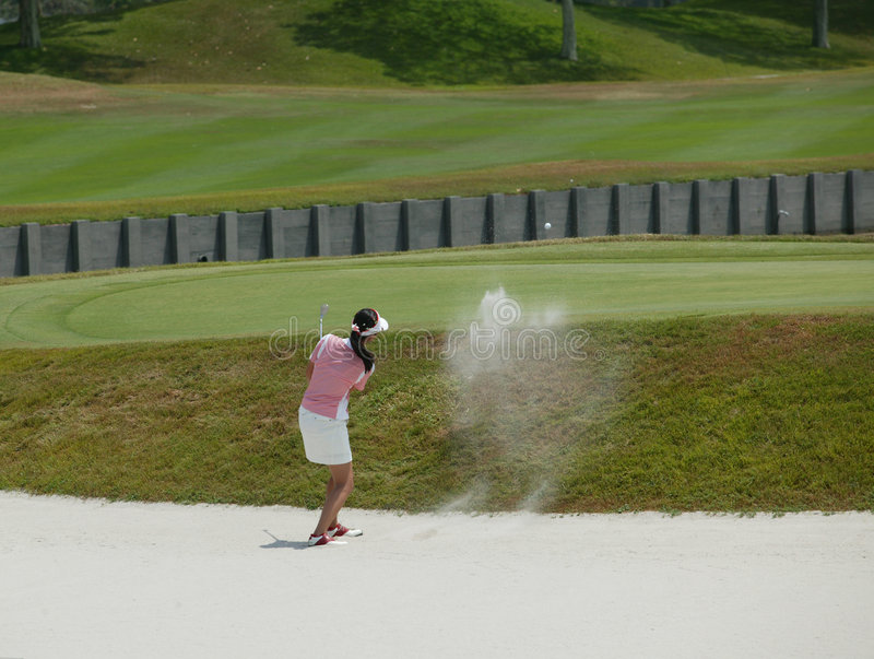 Lady Golfer stock photography