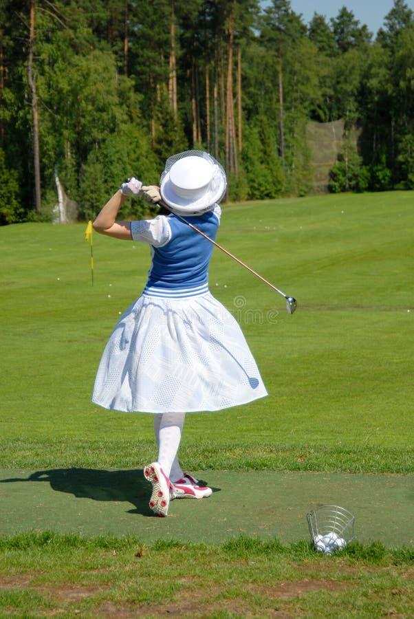 Lady golfer swing stock photo