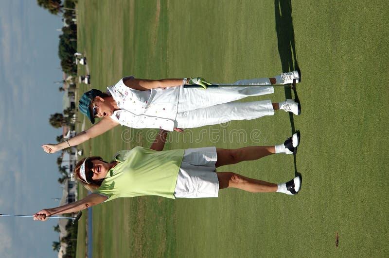 Lady Golfers victory stock photo