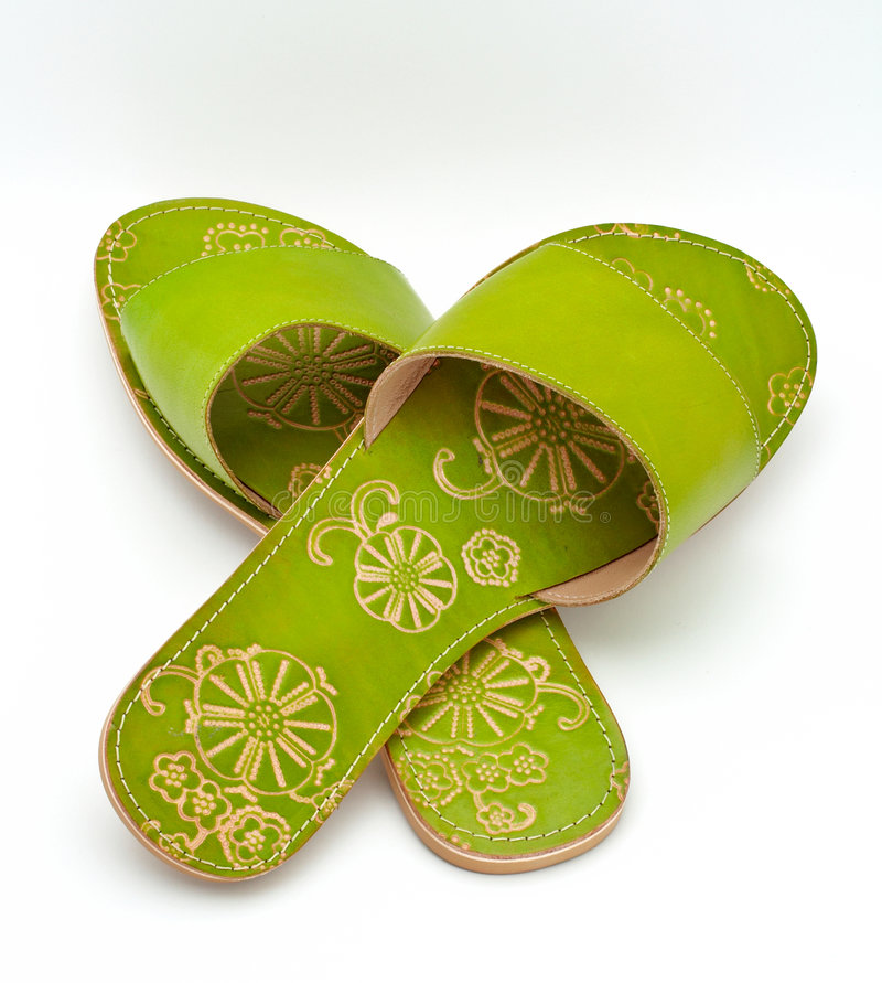 Lady green sandals stock photo