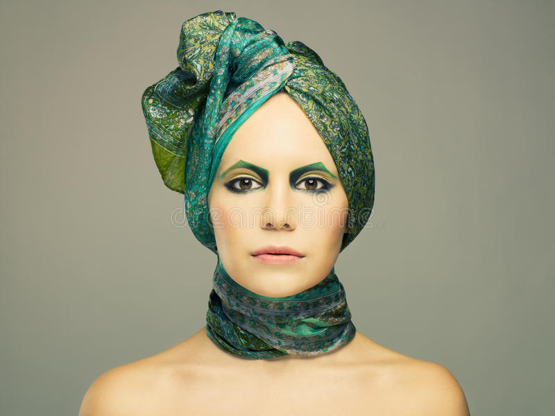 Download Lady in green turban stock photo. Image of cosmetics - 23571014
