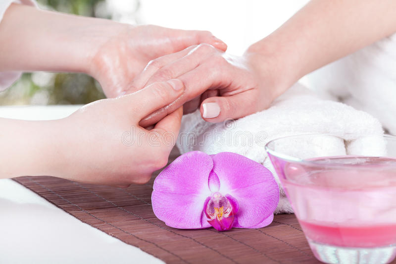 Lady during hand massage royalty free stock photography