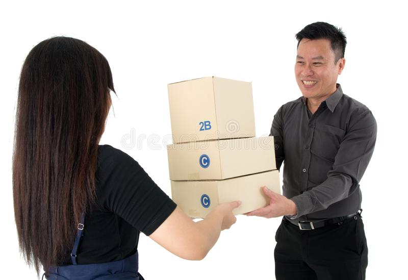 Lady handing over a stack of package to a happy businessman isolated on white background. Lady handing over a stack of package with special service to a happy stock photos