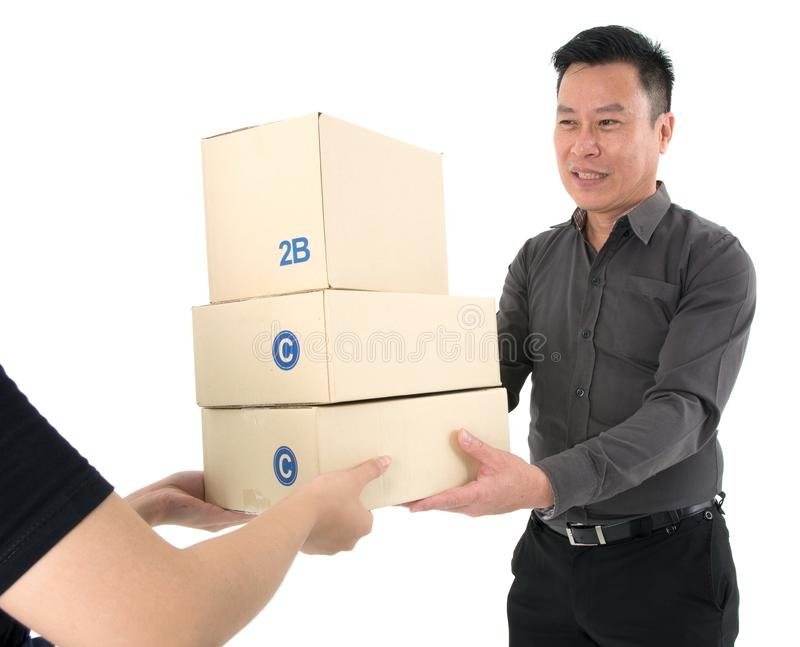 Lady handing over a stack of package to a happy businessman isolated on white background. Lady handing over a stack of package with special service to a happy royalty free stock photography