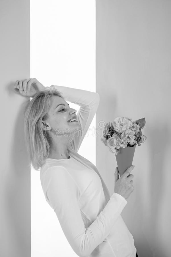 Lady happy received flowers from secret admirer. Who is her secret admirer Woman smiling dreamy try guess who fall in. Love with her. Girl hold bouquet flowers royalty free stock photos