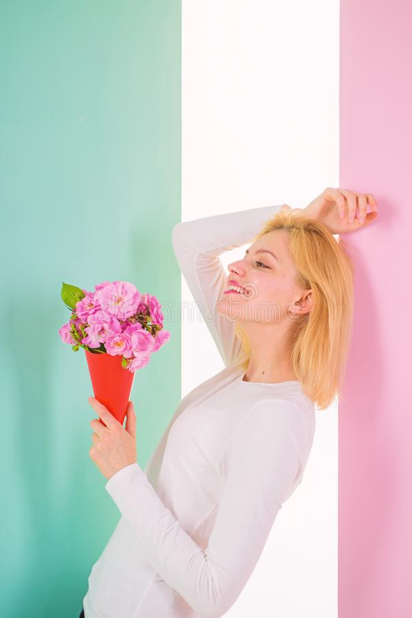 Lady happy received flowers from secret admirer. Who is her secret admirer Woman smiling dreamy try guess who fall in. Love with her. Girl hold bouquet flowers royalty free stock image