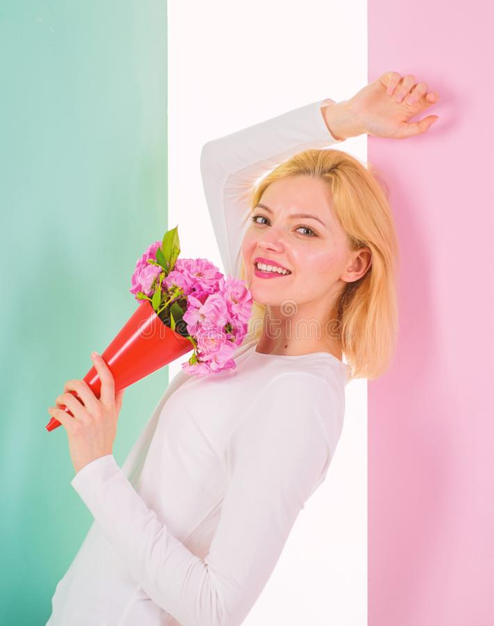 Lady happy received flowers from secret admirer. Woman smiling dreamy try guess who fall in love with her. Girl hold. Bouquet flowers enjoy fragrance and feels stock photo