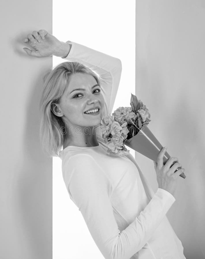 Lady happy received flowers from secret admirer. Woman smiling dreamy try guess who fall in love with her. Girl hold. Bouquet flowers enjoy fragrance and feels royalty free stock photography