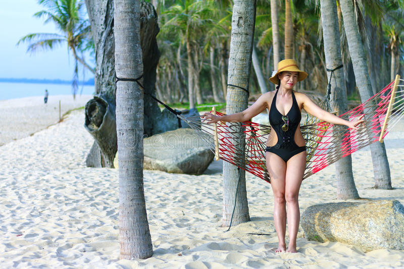 Lady happy sunshine. In Ban Krut Beach, at Prachuap Khirikhun Province Thailand stock photo