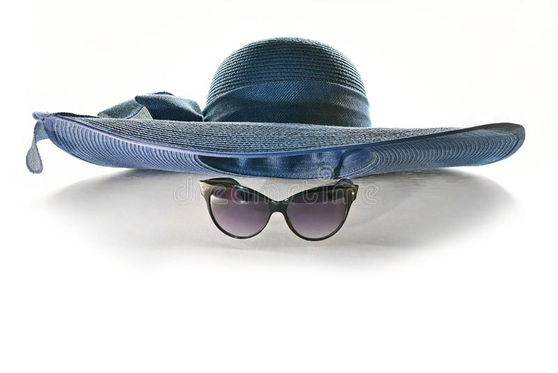 Hat and sunglasses on white background stock image