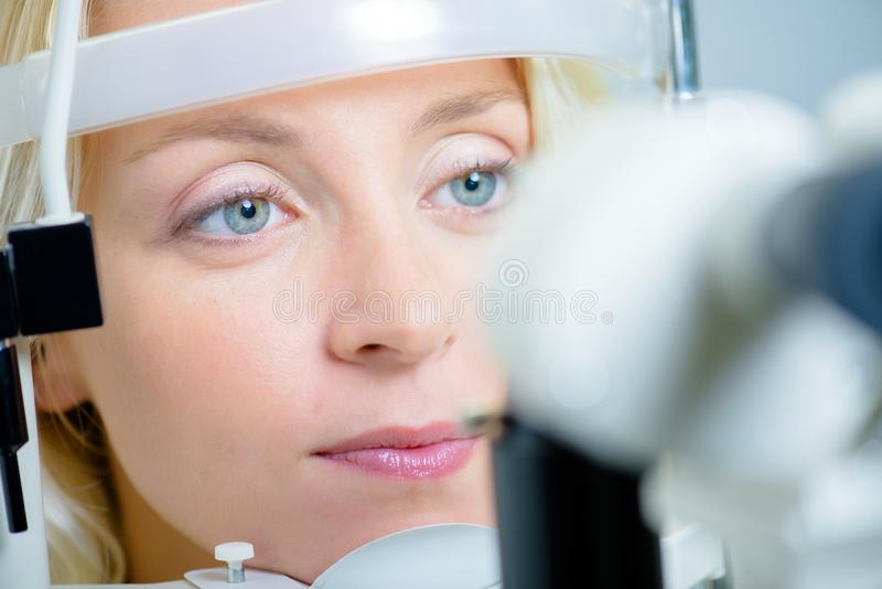 Lady having eye examination stock images