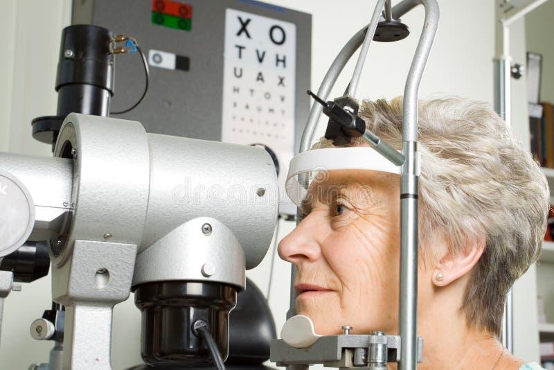 Lady having eye test examination stock images
