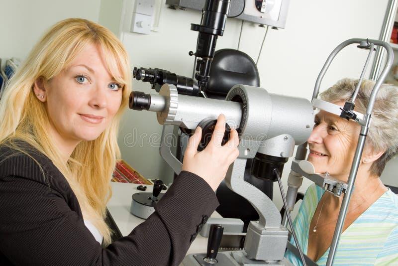 Lady having eye test examination stock photography