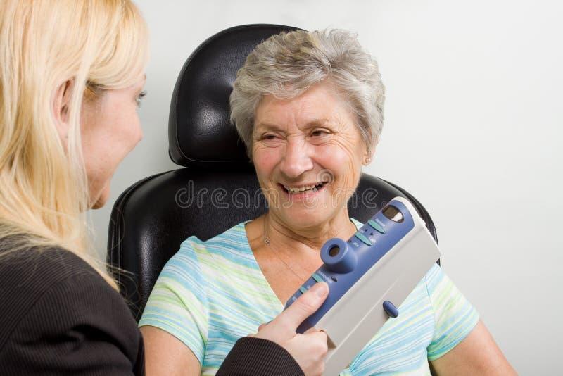 Lady having eye test examination stock photo