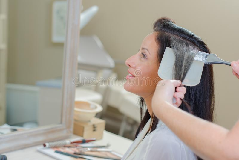 Lady having hair dyed royalty free stock photos