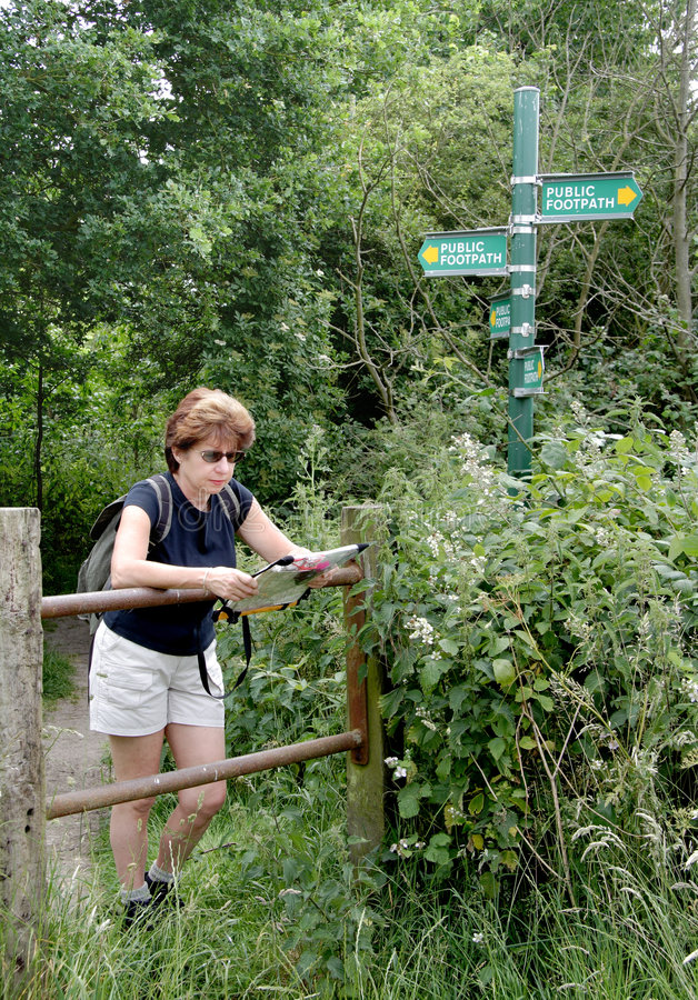 Download Lady Hiker reading a Map stock photo. Image of reading - 1401644