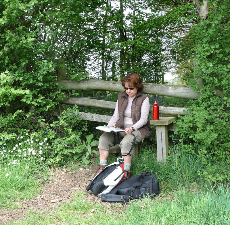 Lady Hiker Reading A Map Royalty Free Stock Images