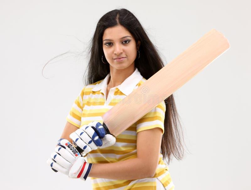 Lady holding cricket bat royalty free stock photos