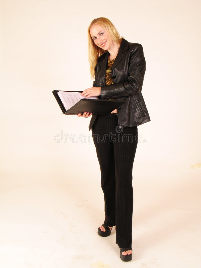 Lady holding a folder with papers. Woman holding a folder stock photo