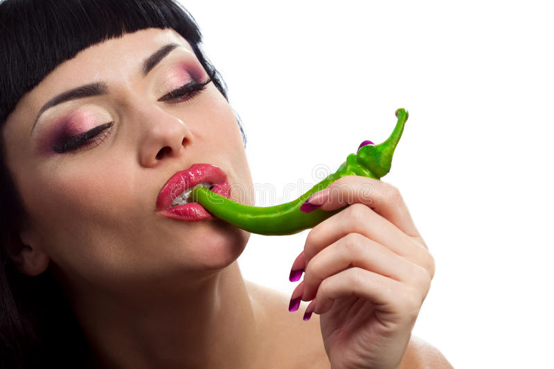 Lady holding green chilli peppers stock image