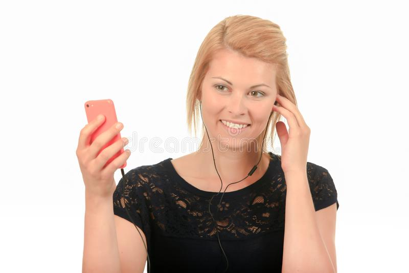 Lady holding smartphone wearing earphones stock images