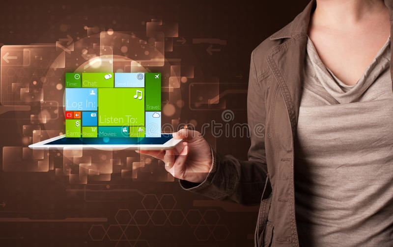 Lady holding tablet with modern software operational system royalty free stock image