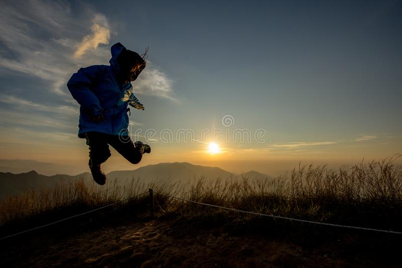 Lady in Jump action with sunset background royalty free stock photo