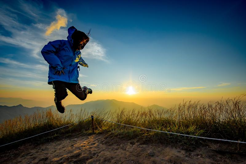 Lady in Jump action with sunset background royalty free stock photography
