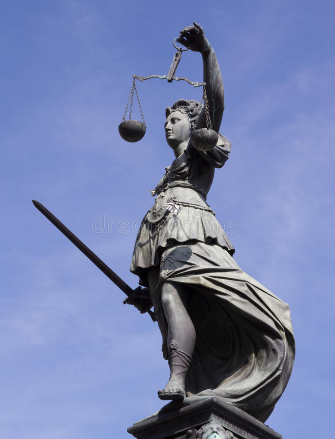 Lady Justice. Statue of Lady Justice in front of the Romer in Frankfurt - Germany royalty free stock image
