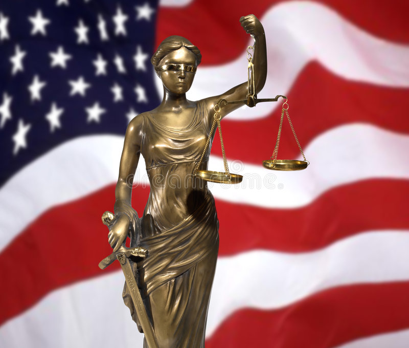 Lady of Justice. On rippled US flag stock image