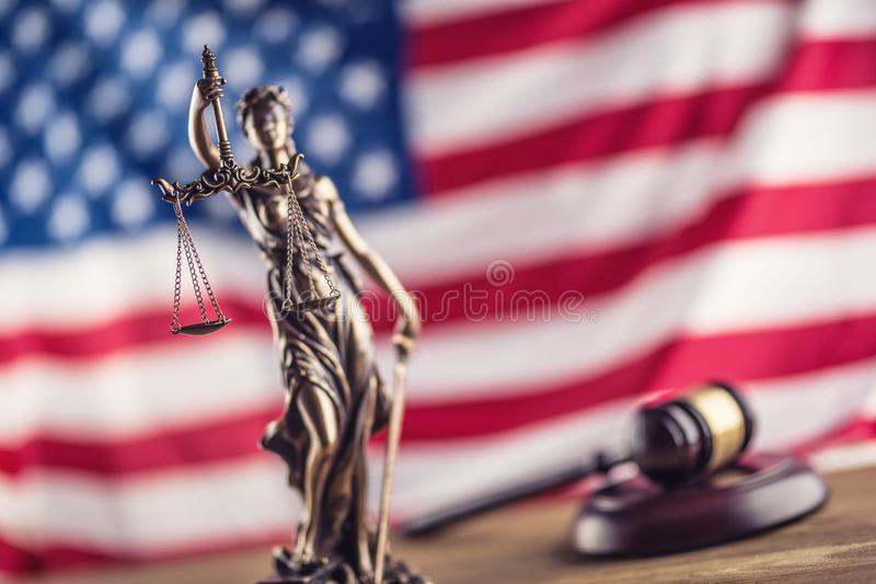 Lady Justice and American flag. Symbol of law and justice with U. SA Flag stock image