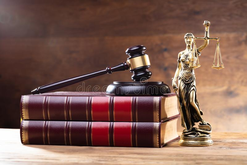 Lady Justice Near Gavel Over Law Book royalty free stock photo